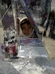 My five-year-old daughter, Lily, peeks through one of the ice sculptures at the Crystal Garden.
