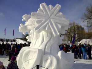 A massive snowflake carved out of ice and snow at the Snowflake Kingdom.