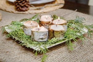 Birch bark candle holders are a DIY Christmas decorating project.