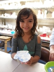 Lily shows off her creation - ready for the kiln!