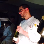 Chef Morden introduces one of the wines that is about to be served.